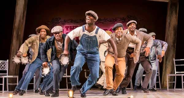 The Scottsboro Boys: (L-R) Keenan Munn-Francis (Eugene Williams), Emmanuel Kojo (Clarence Norris), Rohan Pinnock-Hamilton (Olen Montgomery), Carl Spencer (Andy Wright), James T Lane (Ozie Powell), Joshua Da Costa (Roy Wright), Brandon Victor Dixon (Haywood Patterson), Dex Lee (Charles Weem), Emile Ruddock (Willie Roberson).
