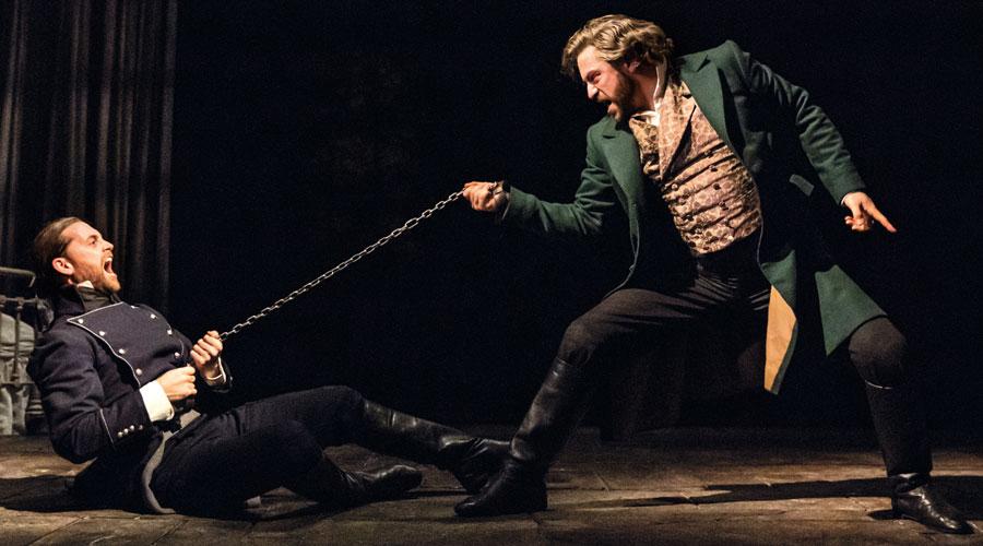 Jon-Robyns-as-Jean-Valjean-and-Bradley-Jaden-as-Javert-–-Photographer-Johan-Persson